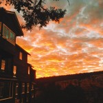 Kolb Studio in foreground, a beautiful sunset in the background