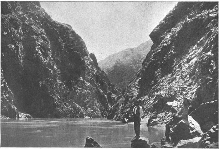 1890s photo of tourists standing at the Colorado River within Grand Canyon.