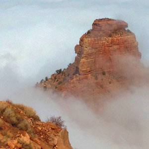 Clouds surround O'Neill Butte during a Grand Canyon atmospheric inversion